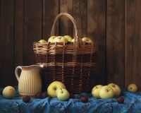 Apples. Still life with apples in a basket and blue cloth Royalty Free Stock Image