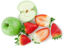 Apples and strawberry. Fresh green apples and strawberry on a white background Stock Image