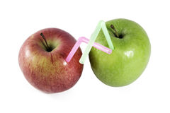 Apples with straws. Very fresh apples fruit juice with straws isolated on white background Stock Images