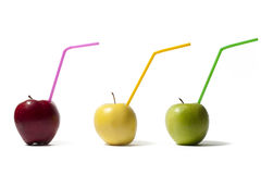 Apples with straws Royalty Free Stock Photo
