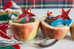 Apples stuffed with chocolate. Dice fruit, impregnating in you r Royalty Free Stock Image