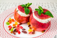 Apples stuffed with curd cheese with mint Royalty Free Stock Photography
