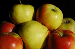 Apples in sunlight. Stockpiled fresh red and green apples Royalty Free Stock Photo