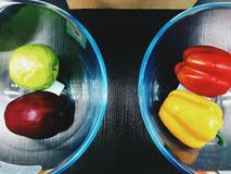apples and sweet pepper lie in a glass bowl Stock Photo