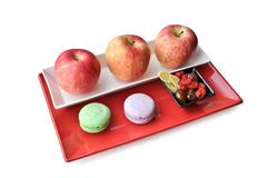 Apples and sweets on a plate Royalty Free Stock Photo