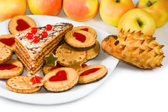 Apples and sweets on  sunlight background Royalty Free Stock Photo