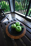 Apples on Table. Exotic setting of an apples on the plate Royalty Free Stock Photography