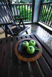 Apples on Table. Exotic setting of an apples on the plate Royalty Free Stock Photos
