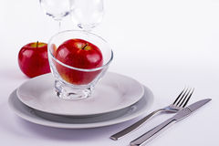 Apples on table laid for celebration. Red fresh apples served on white table as background for menu and invitation Royalty Free Stock Image