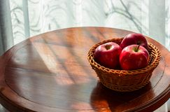 Apples on the table,Morning in the room next to the window royalty free stock image