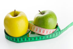 Apples with tailor s ruler. Fruit healthy vitamin diet Royalty Free Stock Photography