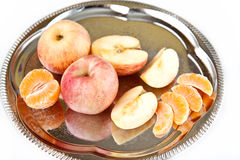 Apples and tangerine. In the tray Stock Photos