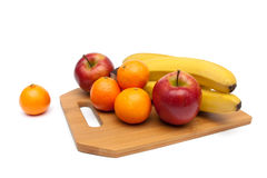 Apples, tangerines and bananas close-up Royalty Free Stock Photos