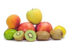 Apples, tangerines, peaches and kiwis. A few apples, tangerines and kiwis on a white background royalty free stock photo