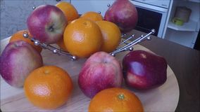 Apples and tangerines on table stock video
