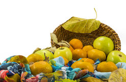 Apples, tangerines and a wicker basket on a white background stock photo