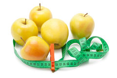 Apples tape measure and clothespin Royalty Free Stock Photography