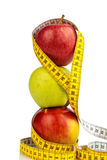 Apples with tape measure on. Several apples with a tape measure. symbolic photo for diet and healthy, vitamin-rich diet Stock Photography
