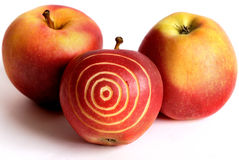 Apples-target. Three red apples with the image of a target Stock Photos