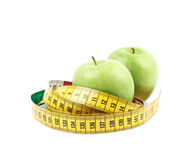 Apples tied with the measuring tape Royalty Free Stock Photo