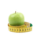 Apples tied with the measuring tape Royalty Free Stock Image