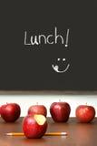 Apples on top of school desk Stock Photos