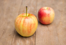 Apples. On the top of wooden table. some fruit, two , big and small, 2 sizes, different, red , wooden table Royalty Free Stock Photos