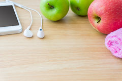 Apples, towel and smart phone Stock Photos