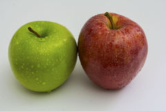 Apples. Two apples with moisture on them against a white back ground Royalty Free Stock Image