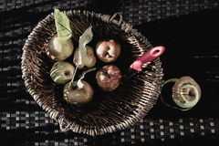 Apples vintage feeling. Apples in a basket, bleached look, autumn feeling, on an old withered metal white chair Royalty Free Stock Photo