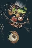 Apples vintage feeling. Apples in a basket, bleached look, autumn feeling, on an old withered metal white chair Stock Photo