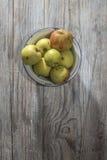 Apples in vintage metal cup Royalty Free Stock Image