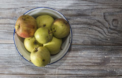 Apples in vintage metal cup Stock Photos
