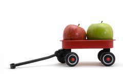 Apples in Wagon. Green and red apple in a small red wagon Royalty Free Stock Photo