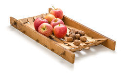 Apples and walnuts on a wooden frame Stock Images