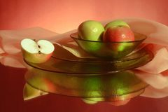 Apples and ware on a red background Royalty Free Stock Photo