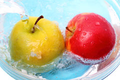 Apples in water Royalty Free Stock Photos