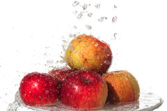 Apples and water. Royalty Free Stock Photos