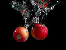 Apples in water Royalty Free Stock Image
