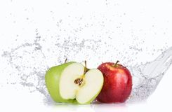 Apples with water splashes. Isolated on white background Stock Images