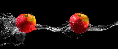 Apples in water stream Stock Image