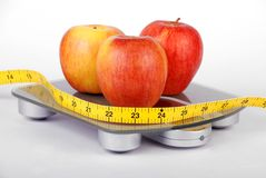 Apples on weighing scales Stock Photography