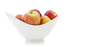 Apples in a white china bowl. On white background stock photos