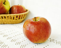 Apples on white embroidered napkin Stock Images