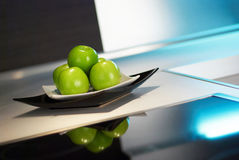 Apples on white kitchen's table Stock Photography