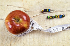 Apples and white measuring tape on wooden table Royalty Free Stock Images