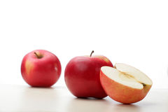 Apples on a white table. Tree red apples on a white table royalty free stock photography