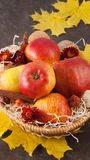 Apples in wicker basket Stock Photo