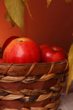 Apples in a wicker basket Royalty Free Stock Photo