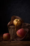 Apples in a wicker basket Stock Images